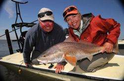Capt. Gregg, Kathy Beck, and a nice redfish!